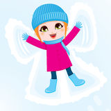 Snow Angel Girl. Happy little girl lying down on the ground making a snow angel Stock Image