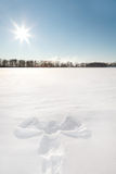 Snow angel. In sunny day Royalty Free Stock Photo