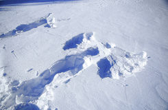 Snow angel in winter and Footprints in the snow Stock Image