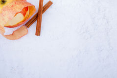 Snow, apple and cinnamon Royalty Free Stock Photos