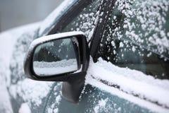 Snow around car mirror. Left wing left car mirror under the snow Stock Image