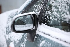 Snow around car mirror. Left wing left car mirror under the snow Royalty Free Stock Photography