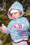 Snow is Awesome. A baby toddler girl playing iwth snow Stock Image