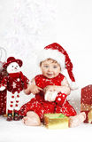 Snow Baby. Baby girl sitting and playing  in snow Stock Image
