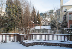 Snow in Back Yards of Homes Royalty Free Stock Images