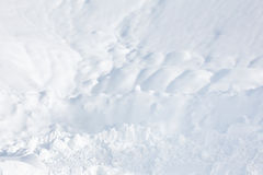 Snow background. Snow waves on field in winter Stock Images
