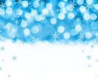 Snow Background. Snowy landscape with falling snow flakes and blue bokeh Stock Photos