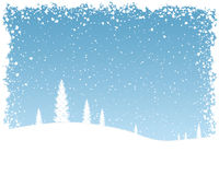 Snow Background. Snowy landscape with falling snow flakes and blue sky Stock Photos