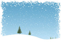 Snow Background. Snowy landscape with falling snow flakes and blue sky Stock Photography