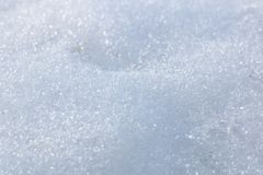 Snow background with detailed snowflakes, macro photo of snow. Snow background with detailed snowflakes close up, macro photo of real snow, background or texture royalty free stock images