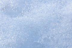 Snow background with detailed snowflakes. Macro photo of snow. Snow background with detailed snowflakes close up. Macro photo of real snow. Background or texture stock photo