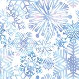 Snow background. Snowflakes texture. Blue snow falling on white Stock Image
