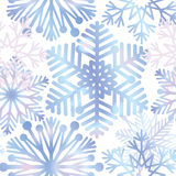 Snow background. Snowflakes texture. Blue snow falling on white Stock Photography