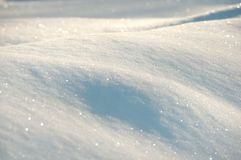 Snow background in white and blue. Glittering snow background in white and blue Royalty Free Stock Photography
