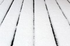 Fresh white snow on the pavement texture stock photo