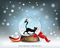 Snow Ball. Elegant winter Christmas background with red ribbon and glass snow ball with black cat and bird inside Royalty Free Stock Image