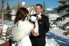 Snow Ball Fight. Bride and groom throwing snow at each other Royalty Free Stock Photo