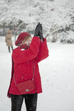 Snow ball fight. People fighting Stock Photography
