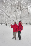 Snow ball fight. Young couple in a snowball fight Royalty Free Stock Photography
