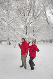 Snow ball fight. Young couple in a snowball fight Stock Photo