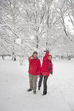 Snow ball fight. Young couple in a snowball fight Stock Photos