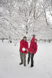Snow ball fight. Young couple in a snowball fight Royalty Free Stock Photo