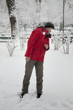 Snow ball fight. Young man in a snowball fight Royalty Free Stock Photography