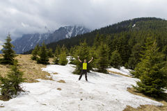 Snow ball fight. Young man in a snowball fight on a mountain landscape Stock Photos