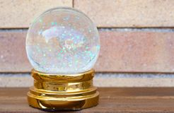 SNOW BALL WITH GLITTER. WALL BACKGROUND royalty free stock image
