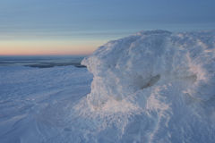 The snow bank on the top of the mountain in the winter evening. Royalty Free Stock Photography