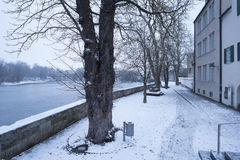 Snow on the banks of Landsberg at Lech river Stock Photos