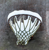 Snow in basketball goal. Snow in a basketball goal royalty free stock images