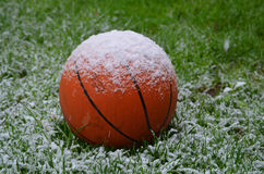 Snow on basketball Stock Images