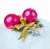Snow and bauble Stock Photography