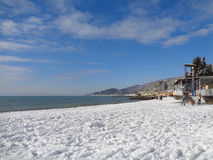 Snow on the beach, Sochi, Russia, Black Sea coast. Cold winter in resort city in southern Russia, much snow on the beach, people walking Royalty Free Stock Photography