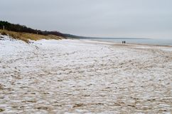 Snow on the beach in Trassenheide, Usedom, Germany royalty free stock photos