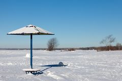 Snow beach in the winter with  umbrella Royalty Free Stock Photos