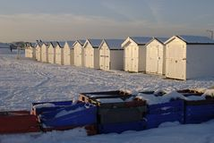 Snow on beach at Worthing. England. Snow on the beach with beach huts at Goring. Worthing. West Sussex. England Royalty Free Stock Images
