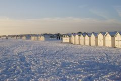 Snow on beach at Worthing. England. Snow on the beach with beach huts at Goring. Worthing. West Sussex. England. Unusual weather - snow not usual for this place Stock Photo