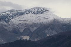 The snow on the beautiful mountains royalty free stock photography