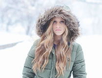 Snow Beauty. Beautiful girl outside in the winter snow stock photography