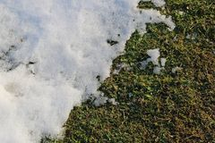 Snow begins to melt at the end of the winter, oblique image stock photo
