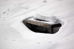 Snow and bench. Wood bench covered with snow Stock Images