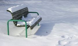 Snow on Bench. Snow on a bench in a park Royalty Free Stock Image