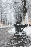 Snow bench winter sidewalk Stock Photos