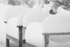 Snow and Benches. Heavy snow on the benches Royalty Free Stock Photos