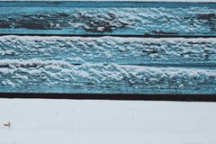 Snow benches wooden paint texture blue white cold winter silence calmness color frozen lines horizontal. Seasons Stock Image