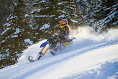 Snow Bike Conversion Kit in winter forest in the mountains. SAKHALIN RUSSIAN - JANUARY 23 : Oleg Bibikov moving Snow Bike Conversion Kit in winter forest in the Royalty Free Stock Photos