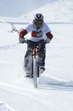 Snow biker downhill Royalty Free Stock Photos