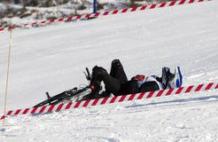 Snow biker downhill after accident. Snow biker downhill in winter mountains Tien Shan Royalty Free Stock Image